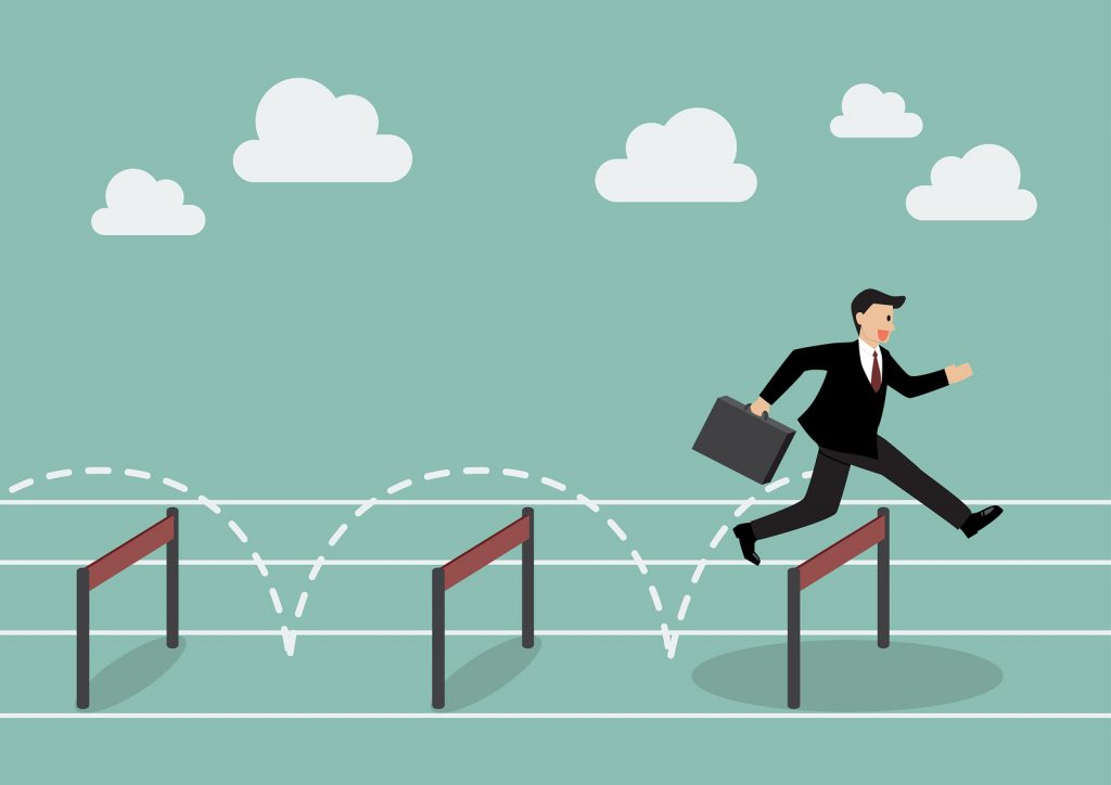 Businessman jumping over hurdle. Business competition concept
